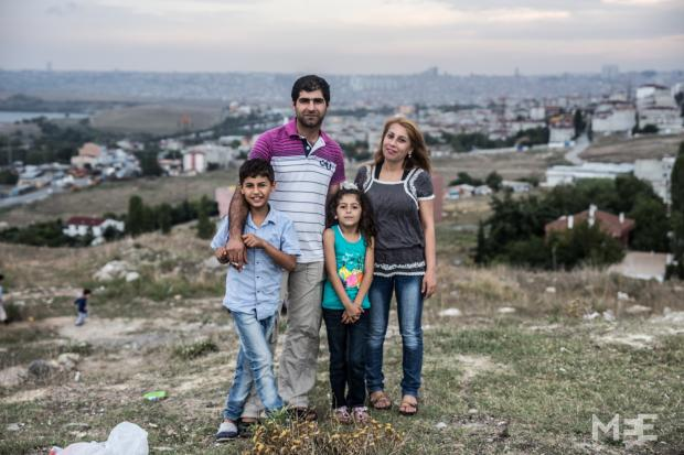 The Nasro family from Aleppo (left to right: Jewan, Mohamed, Rojda, Roshin) with the city of Istanbul in the background (MEE/Willemjan Vandenplas)