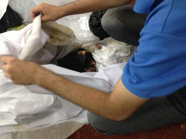 Burnt body of a protester in El-Eman mosque