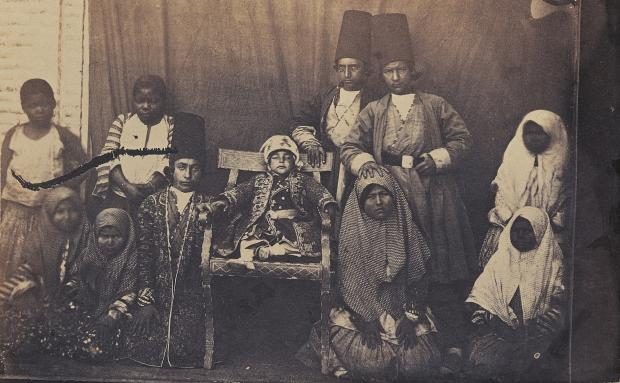 Rediscovering the history of African slavery in Iran - This photo of princes, children of officials and servants was taken in the royal court of Nasir al-Din Shah, the king during the Qajar dynasty in Tehran in the 19th Century. Black children were known as khanezad (house-born) (Courtesy: Behnaz Mirzai)