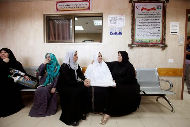 Women wait to be evacuated from al-Aqsa hospital (MEE / Eloise Bollack)