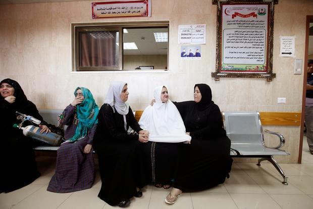Women wait to be evacuated from al-Aqsa hospital (MEE / Eloise Bollack)
