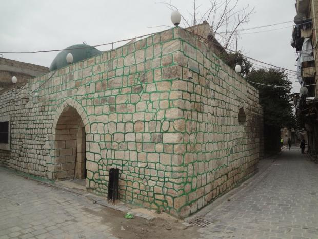 Al-Akhal Mosque, dating to 1485, now bears garish, green-painted mortar (MEE)