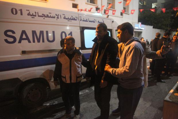 An ailing hunger striker gets taken away by an ambulance (MEE/Thessa Lageman)