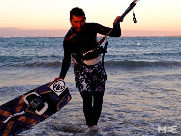 Jalal, who has helped popularise kite-surfing in Libya since the revolution, coming ashore (MEE/Tom Wescott)