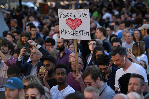 People attend a vigil in Manchester on 23 May 2017 in solidarity with victims of attack at the Manchester Arena (AFP)