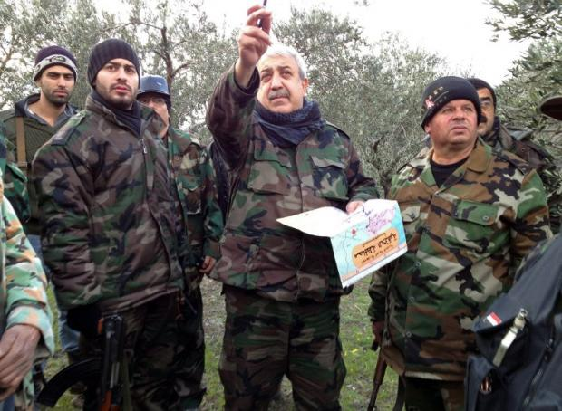 A photo posted on Facebook allegedly shows Mihrac Ural giving instructions to gunmen in Latakia in January 2013 (AFP)