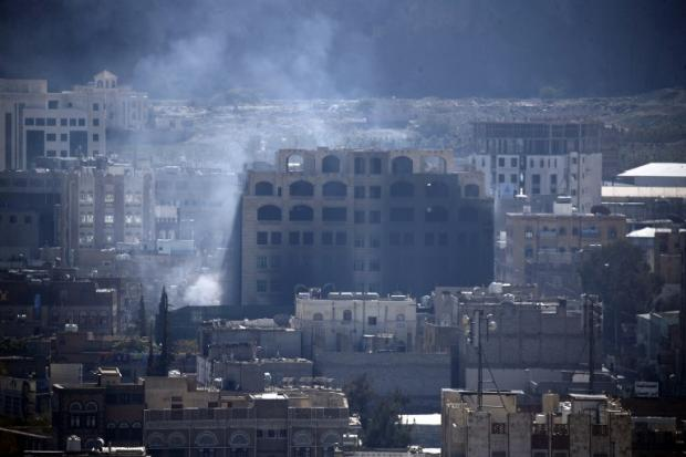 Smoke billows in Sanaa on 3 December 2017 as Houthis and Saleh supporters clash