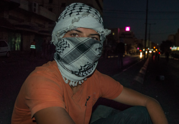 A Palestinian protestor in Bethlehem (MEE / Abed al-Qaisi)