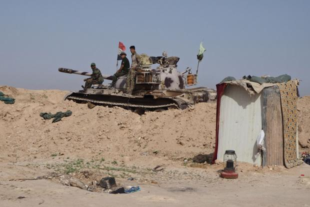 'We shoot anyone we see': Iraqi troops shield border as IS prowls Syrian desert