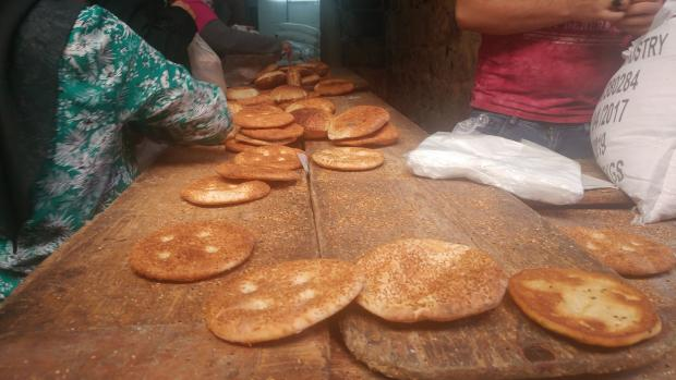 The smell of bread from bakeries tucked into the sides of ancient alleyways point to a lively city (MEE/Ali Harb)
