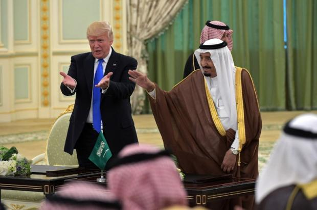 US President Donald Trump and Saudi Arabia's King Salman bin Abdulaziz al-Saud during a signing ceremony at the Saudi Royal Court in Riyadh in May 2017 (AFP)
