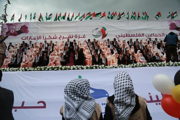 Some 400 Palestinian men and women got married in the mass wedding in Gaza City (MEE/Mohammed Asad)