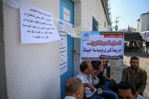 Gaza UNRWA workers go on strike to protest layoffs