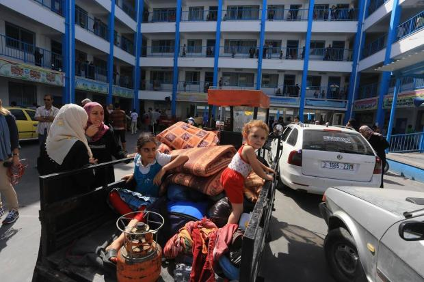 IDPs from northern Gaza take shelter at UNRWA school (MEE / Mohammed Asad)