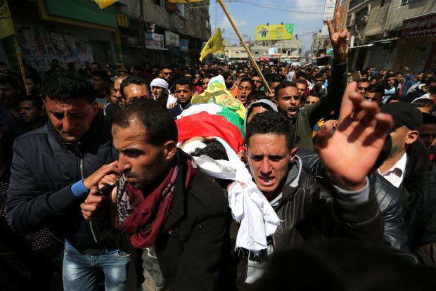 Dozens gather on Gaza border as Palestinians mourn 'heinous massacre'