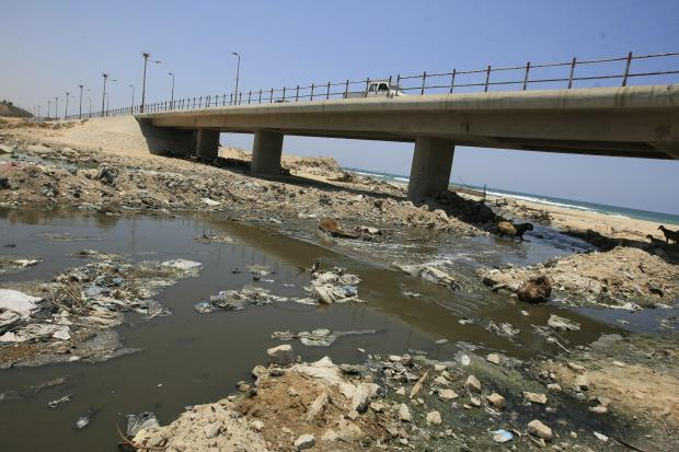 The dangerous sewage situation is likely to exasperated by the bombing (AFP)