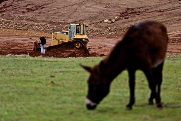 Bulldozers clear the land in the distance that has been confiscated for development (MEE/Nadir Bouhmouch)