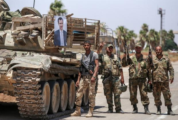 Syrian troops celebrate seizing Nassib border crossing with Jordan