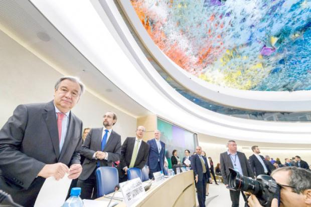 UN Secretary General Antonio Guterres left looks on at the opening of the UNHRC on Monday