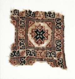 An older textile showing the Bethlehem star, one of the oldest patterns in Palestinian tatreez (Reproduced by permission of Interlink Publishing)