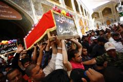 Iraqi men on Sunday carry coffin of protester killed in clash with security forces guarding Baghdad's green zone, during his funeral in Iraq's holy city of Najaf. (AFP)