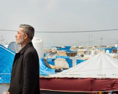 Hamid Sultan walks down a side road Bardarash Refugee Camp (MEE/Taylor Smith)