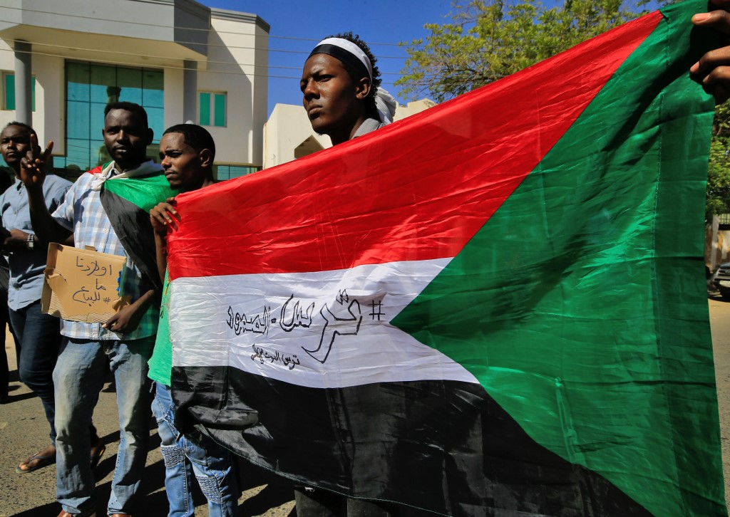 Sudanese demonstrators gather outside the Foreign Ministry in the capital Khartoum on 28 January 2020 to protest at UAE recruitment for wars in Yemen and Libya (AFP)