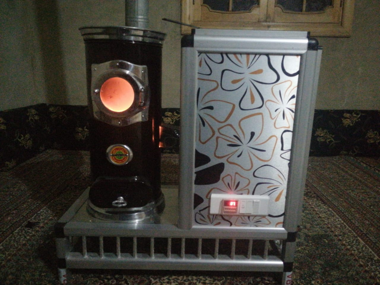Hussein Ahmed keeps his home warm by burning pistachio shells in this specialized oven (MEE/Hussein Ahmed)