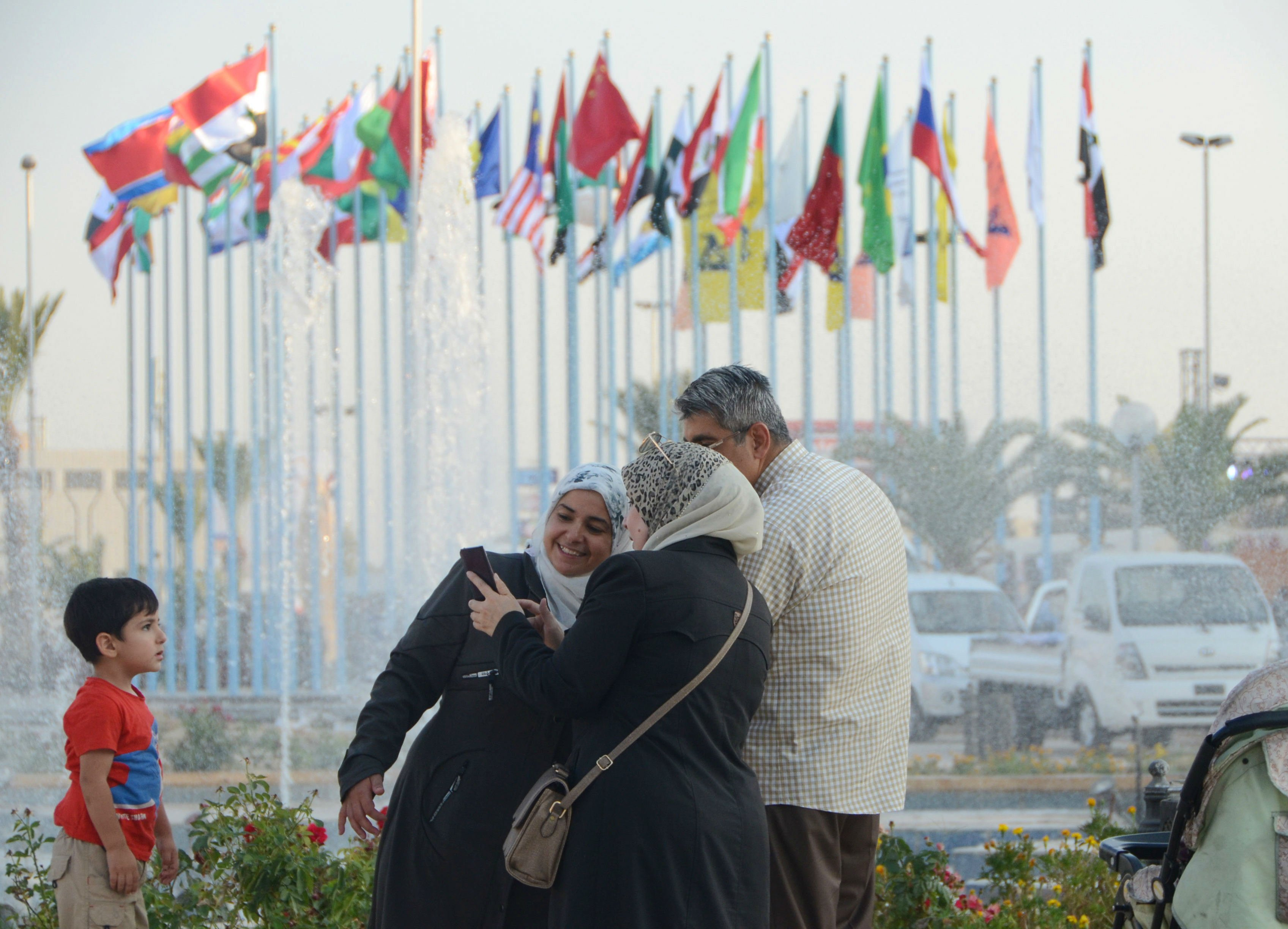 People arrive to attend the Damascus International Fair in the Syrian capital (AFP)