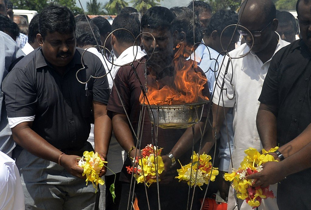 Sri Lankan Tamils hold a ceremony on the outskirts of Jaffna in 2015 (AFP)