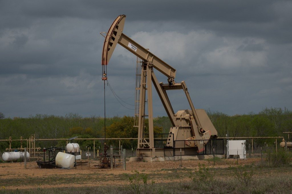 A pump jack at an oil extraction site is pictured in the US state of Texas on 12 March (AFP)
