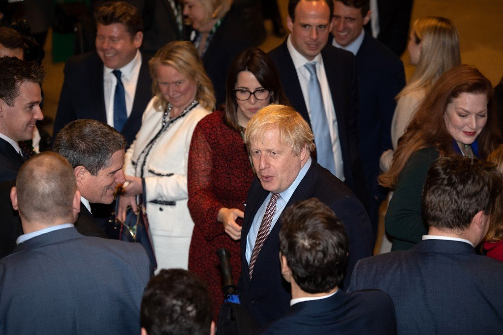 Johnson speaks with newly elected Conservative MPs in London on 16 December (AFP)