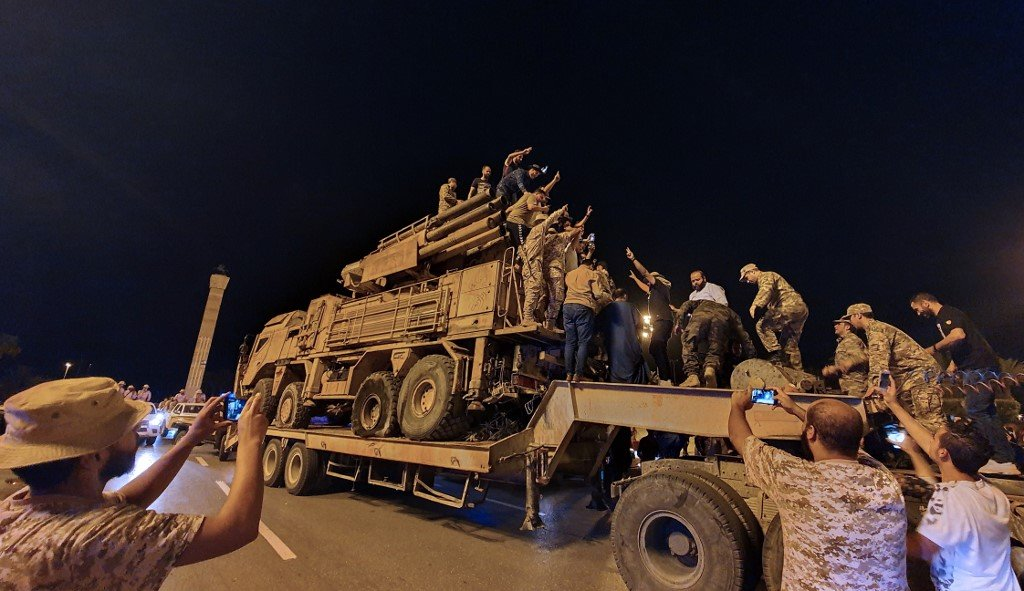 Forces loyal to the GNA parade a Russian-made air defence system truck in Tripoli on 20 May, after its capture at al-Watiya airbase (AFP)