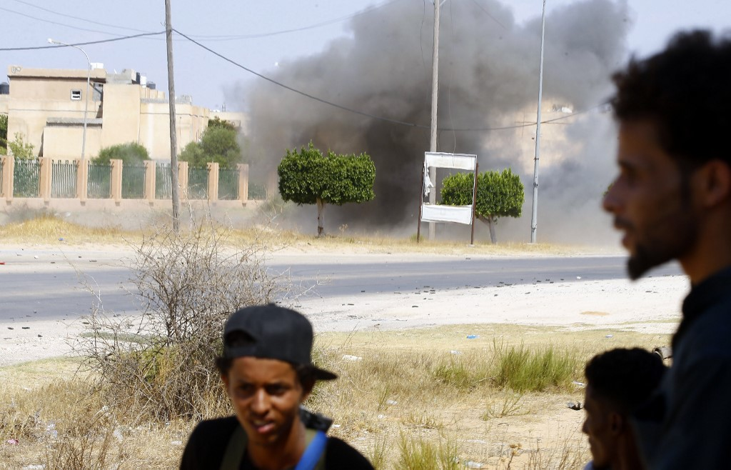 Fighters loyal to the GNA gather during clashes with forces loyal to strongman Khalifa Haftar south of the Libyan capital Tripoli on 21 August (AFP)