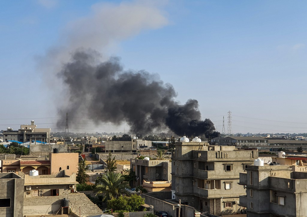 Smoke rises after an air strike near the Libyan capital Tripoli on 29 June (AFP)