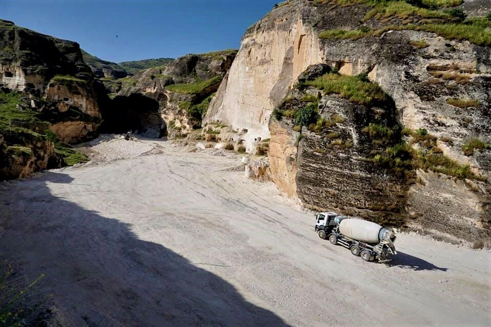 Trucks are seen on the banks of the Tigris river near Hasankeyf, in Turkey's Kurdish-majority southeast, during the construction of the Ilisu dam. (MEE/Nimet Kirac)
