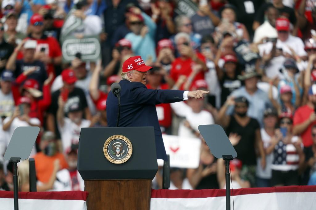 US President Donald Trump speaks in Florida on 29 October (AFP)
