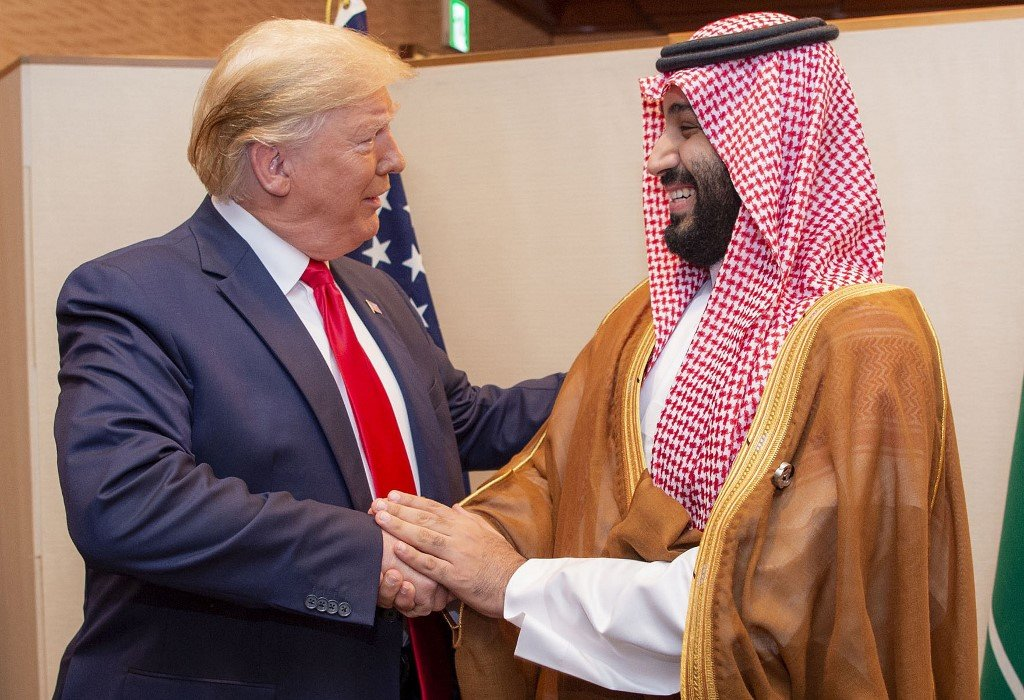 Saudi Crown Prince Mohammed bin Salman shakes hands with US President Donald Trump in Osaka, Japan, in June 2019 (Bandar al-Jaloud/Saudi Royal Palace/AFP)