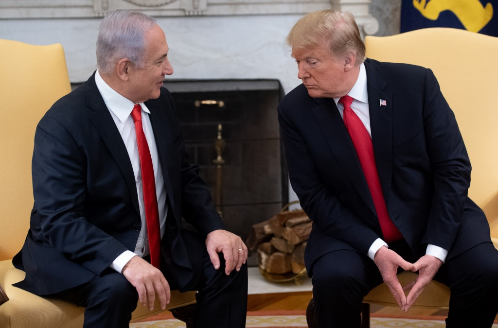 Trump and Israeli Prime Minister Benjamin Netanyahu meet at the White House on 25 March (AFP)