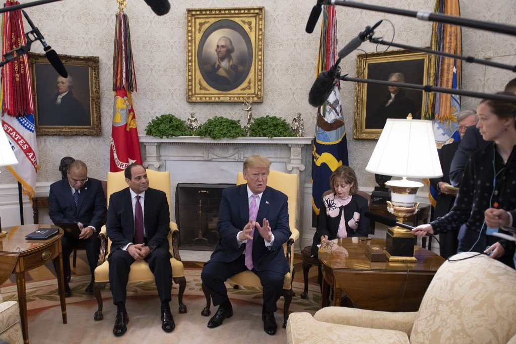 US President Donald Trump meets Egyptian President Abdel Fattah al-Sisi in Washington on 9 April (AFP)