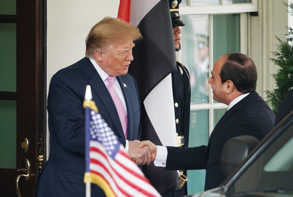 US President Donald Trump greets Egyptian President Abdel Fattah al-Sisi in Washington on 9 April (AFP)