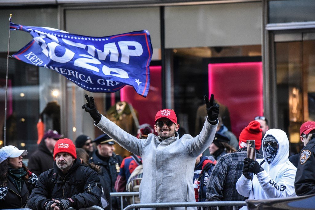 Trump supporters react to anti-fascist protesters in New York on 16 November (AFP)