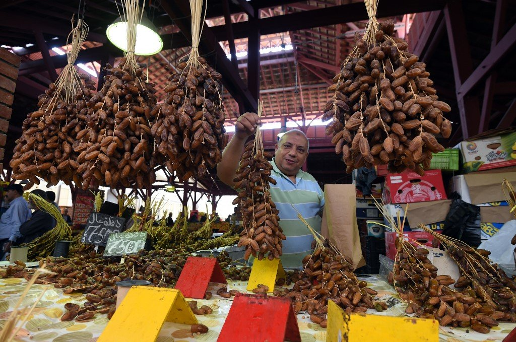 A vendor sells dates, mostly grown in southern Tunisia, at a market in the capital (AFP)