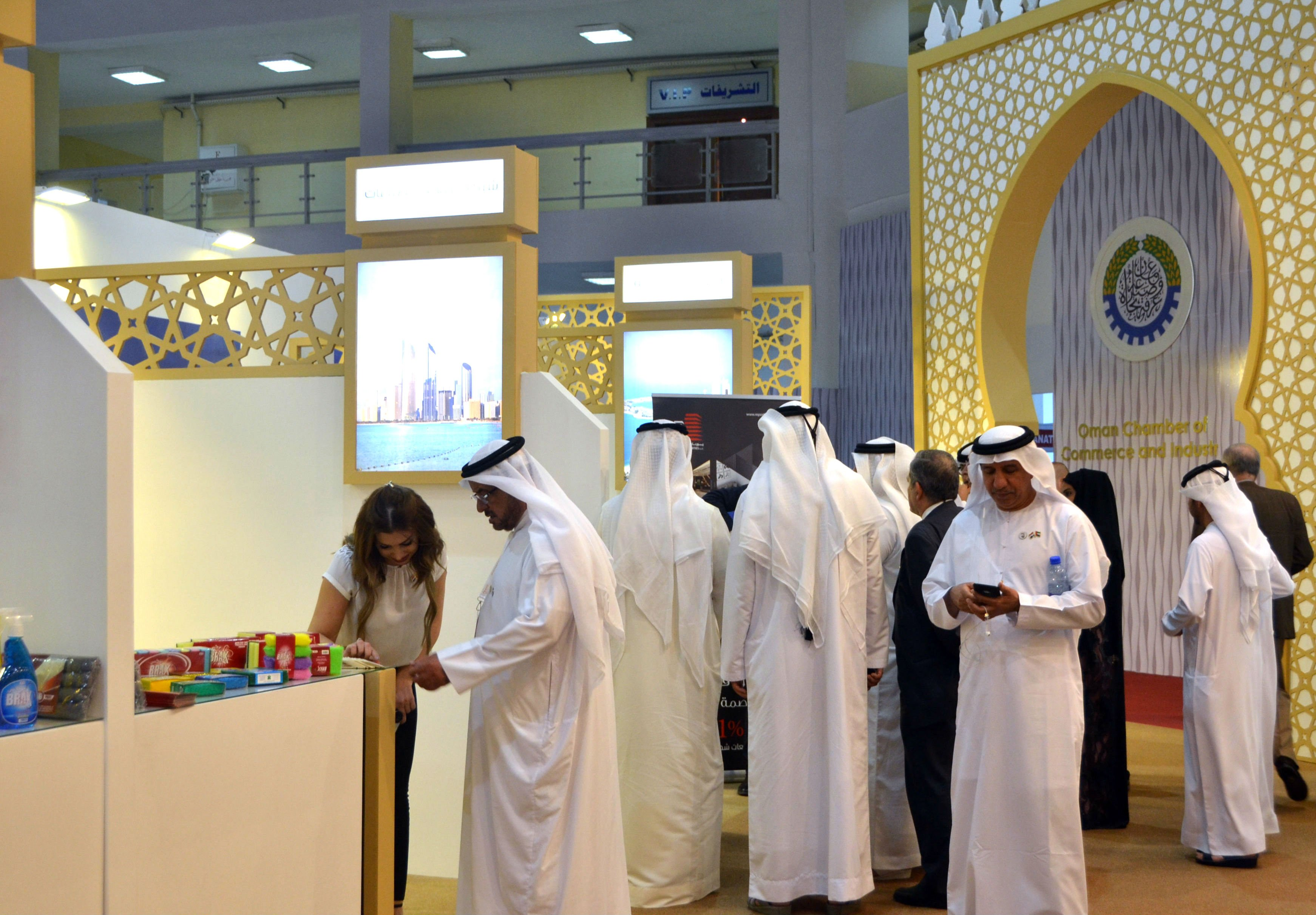 People inspect the stall of Emirati companies at the Damascus International Fair in the Syrian capital (AFP)