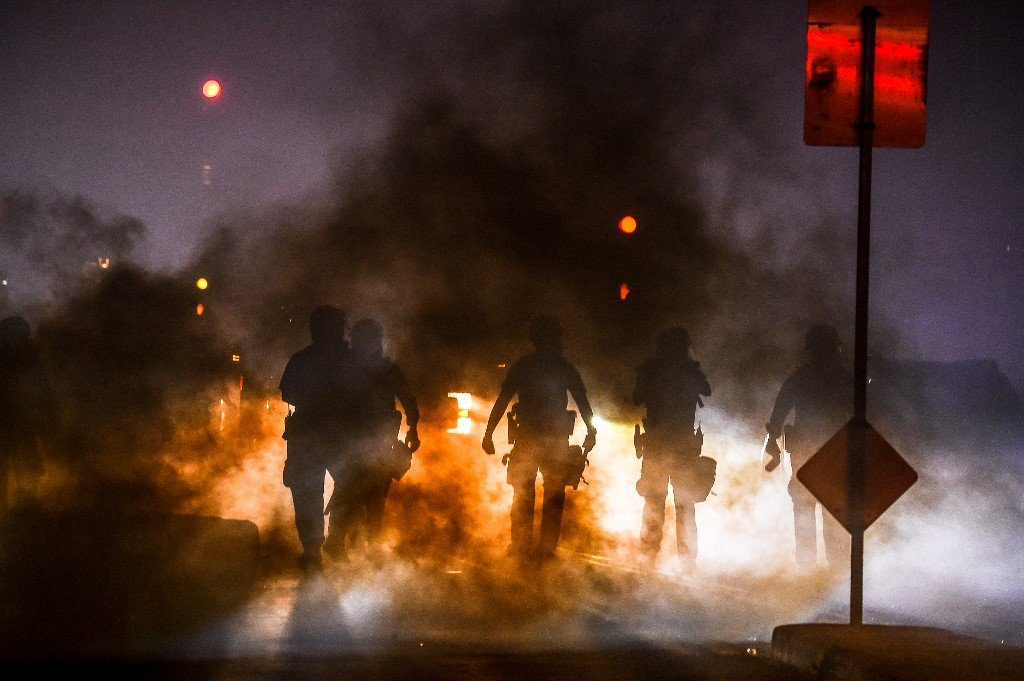 Police use tear gas to disperse protesters on 29 May during a demonstration in Minneapolis, Minnesota, over the death of George Floyd (AFP)