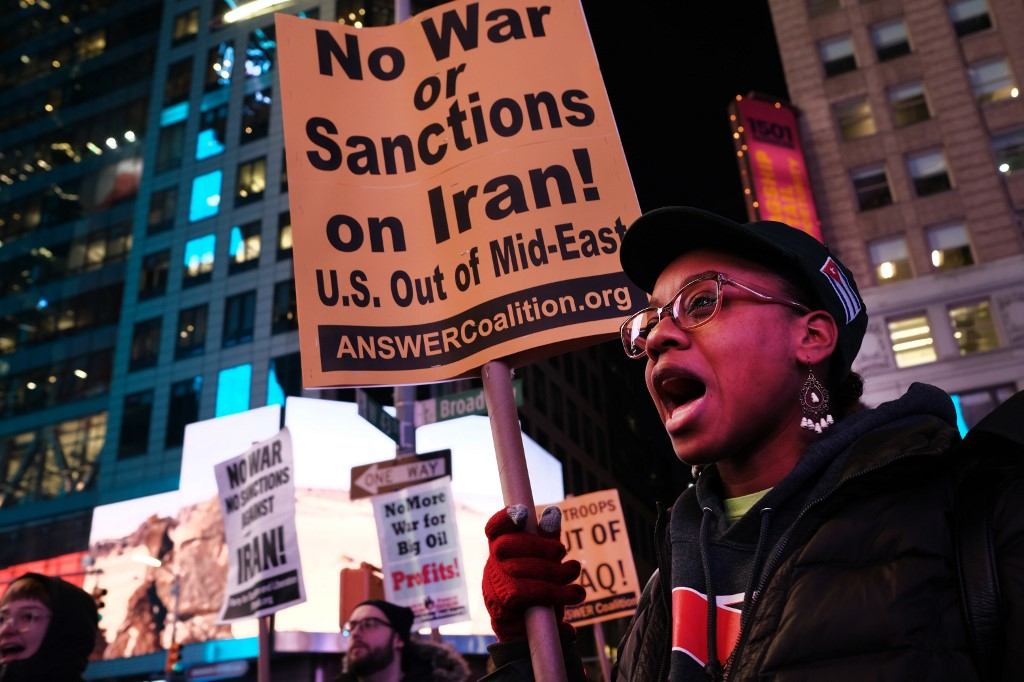 People protest against a US military conflict with Iran in New York on 8 January (AFP)