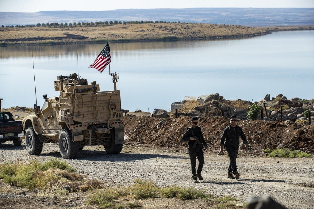 US military vehicles, part of a joint convoy with the YPG, patrol in the northeastern Syrian Hasakeh province in November 2019 (AFP)