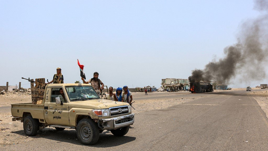 Fighters gather in southern Yemen on 30 August (AFP)
