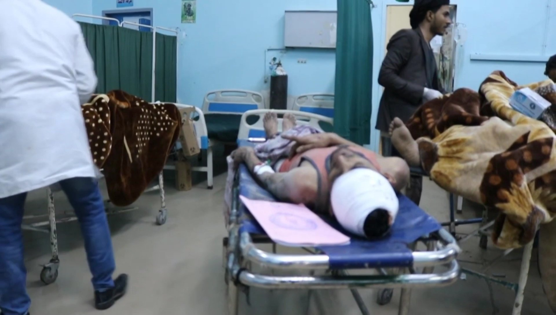 Men wounded by a Saudi-led military coalition air strike lying on beds at a hospital in Dhamar (AFP)