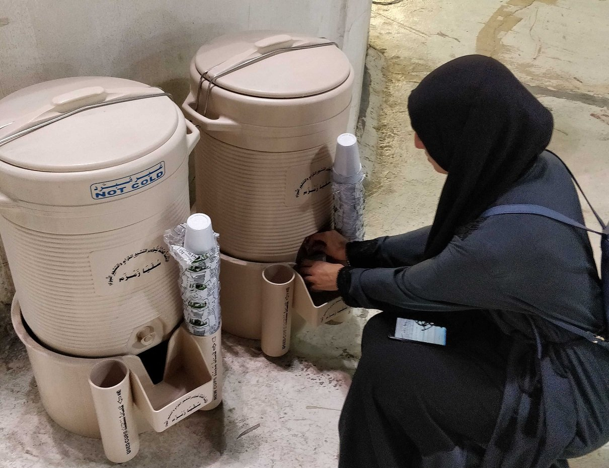 Zamzam water can be found throughout the Masjid al-Haraam, allowing pilgrims to quench their thirst and use it to make supplications to God (MEE/Nadda Osman)
